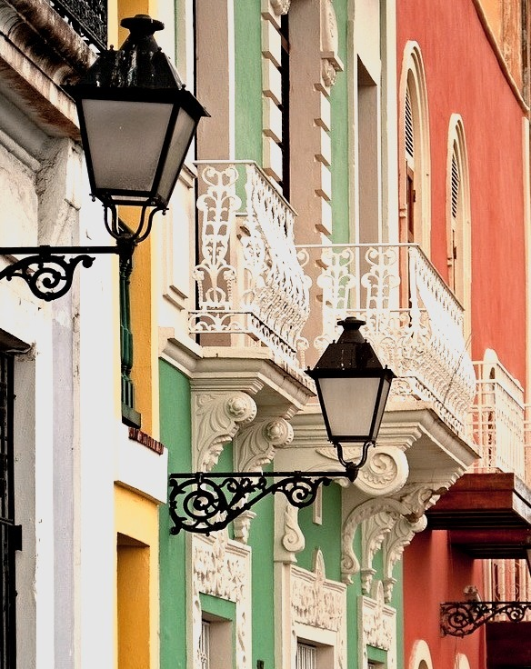 Lamps and balconies on brightly colored buildings, San Juan, Puerto Rico